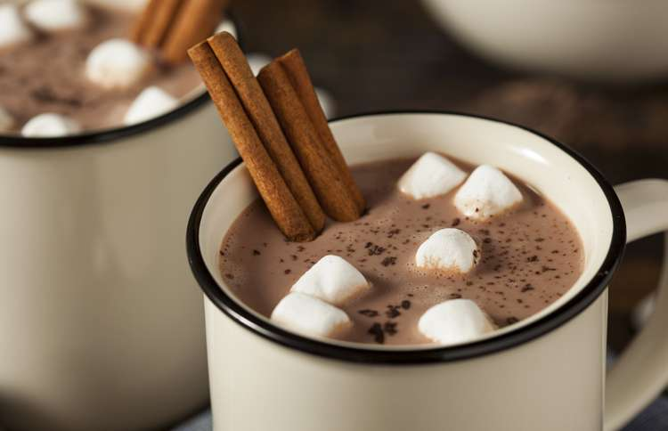 Guideposts: Mugs of hot chocolate with marshmallows and cinnamon sticks