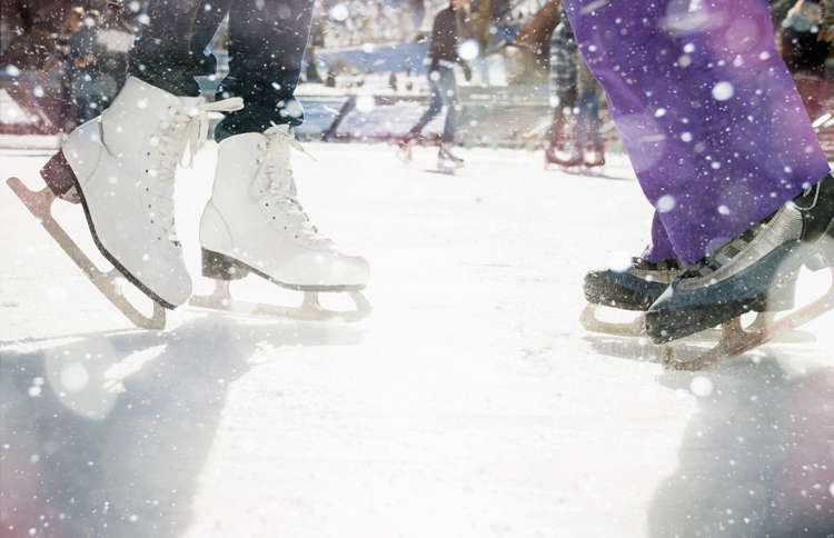 Guideposts: A close-up shot of ice skaters' feet