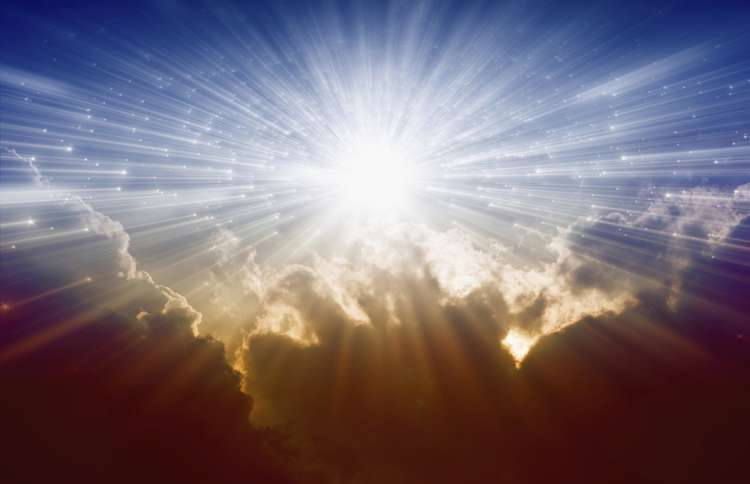 Guideposts: Heavenly beams of light from the sun peek out over the clouds