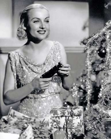 Guideposts: Comedienne Carole Lombard decks the halls in time for Christmas.