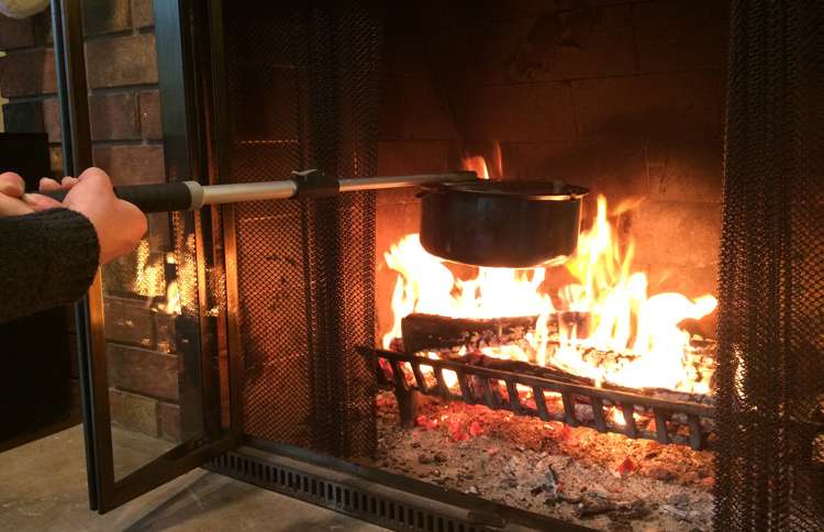 Guideposts: A long-handled popcorn popper is held out over the flames of a fireplace