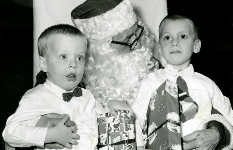 Guideposts: Two boys pose for a picture on Santa's lap
