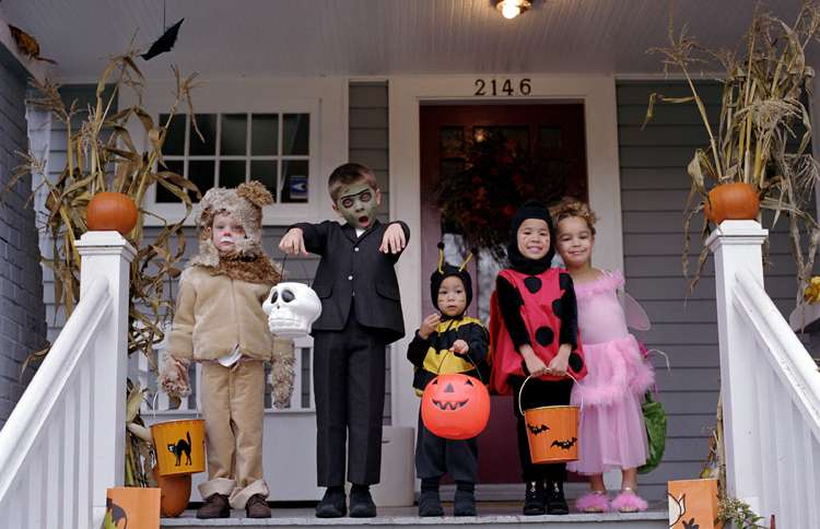 Guideposts: Five very cute trick-or-treaters smile at us from the porch of a welcoming home.