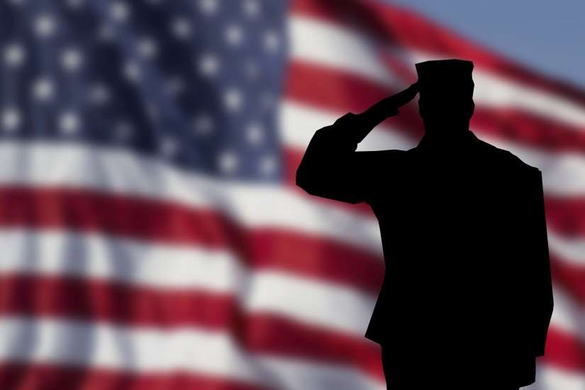 A soldier saluting the American Flag