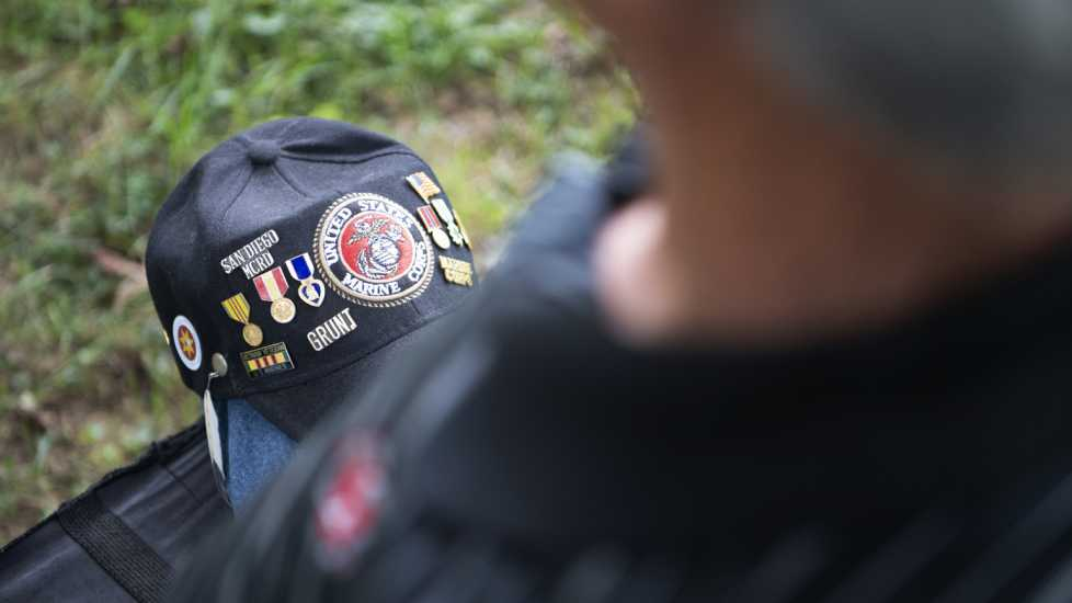 Eddie's cap, which memorializes his time in Vietnam, rests in his lap.