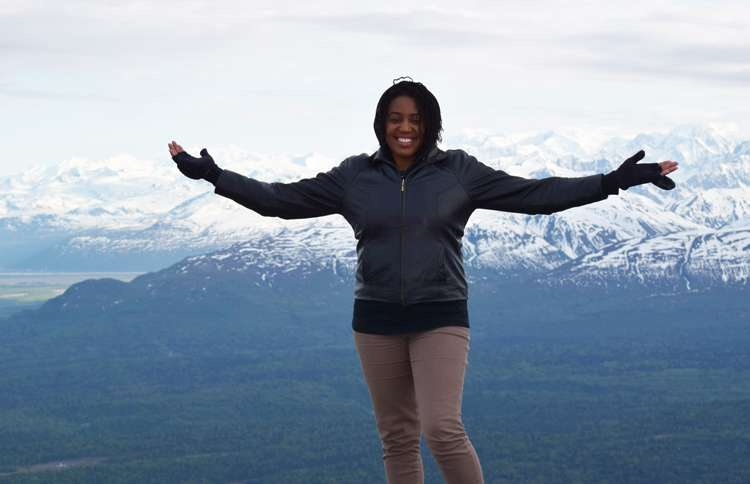 Senior Digital Editor Brooke Obie stands atop a plateau in the Tordrillo Mountain Range near Winterlake Lodge in Alaska