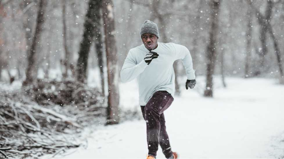 Health myths about Winter: You shouldn't go for that morning run in the winter. man on a morning run. better living health wellness
