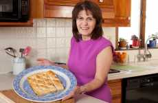 Nursel Aydin poses with a plate of her homemade baklava.