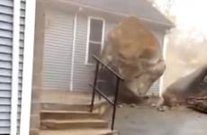 A huge boulder comes to a stop just inches before crushing a church.