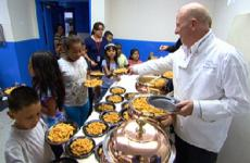 Bruno Serato, owner of the Whitehouse restaurant in Anaheim, serves the needy