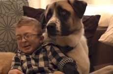 Boy and dog sitting together