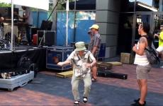 A spry senior citizen dances to some rock 'n' roll.