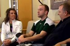 Joel Haler, who experienced a miracule after being paralyzed, with his parents