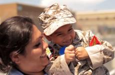 Young Jorge, in full Marine gear, and his mother