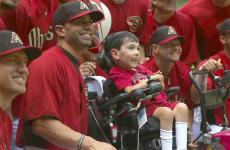 """Kyle Byrd smiles as he poses with his new """"teammates,"""" the Arizona D-Backs"""