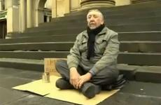 A blind man asking for money on the street