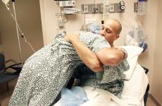 Octavian Maianu (left) hugs Ryan Crecco before the transplant surgery.