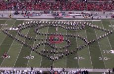 "The Ohio State University Band forms the shape of Superman's ""S"" insignia."