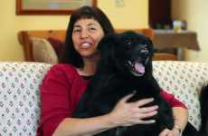 Lori Raineri and her dog, Daisy, who works as a comfort dog for crime victims