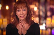 Reba McEntire sings, with hands clasped as if in prayer.