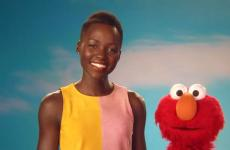 Actress Lupita Nyong'o poses with Elmo on Sesame Street