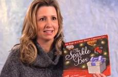 Author Jill Hardie holds her book, The Sparkle Box