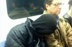Isaac Theil kindly lends a shoulder for an unnamed fellow commuter to rest on.