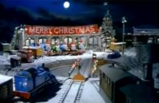 Toy trains outside a diner festooned with Christmas decorations