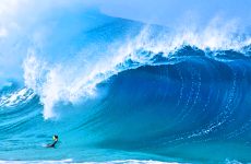 Clark takes a breathtaking photo of a massive wave.