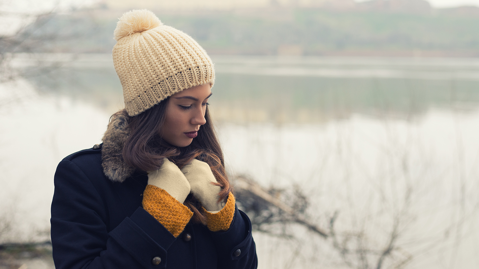 A pensive woman takes a walk on a winter's day